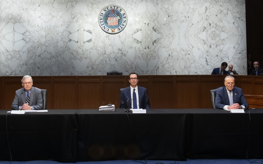 Sen. Mitch McConnell, left, Treasury Secretary Steven Mnuchin and Sent. Chuck Schumer at a meeting Friday to try to come up with an economic response to the coronavirus.