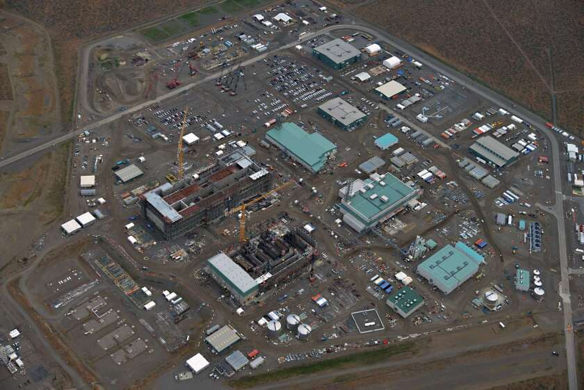 The Energy Department is building an industrial city at its Hanford Site in Washington state to transform 56 million gallons of radioactive sludge into solid glass. The waste treatment plant has three major production buildings, a laboratory and other support facilities.