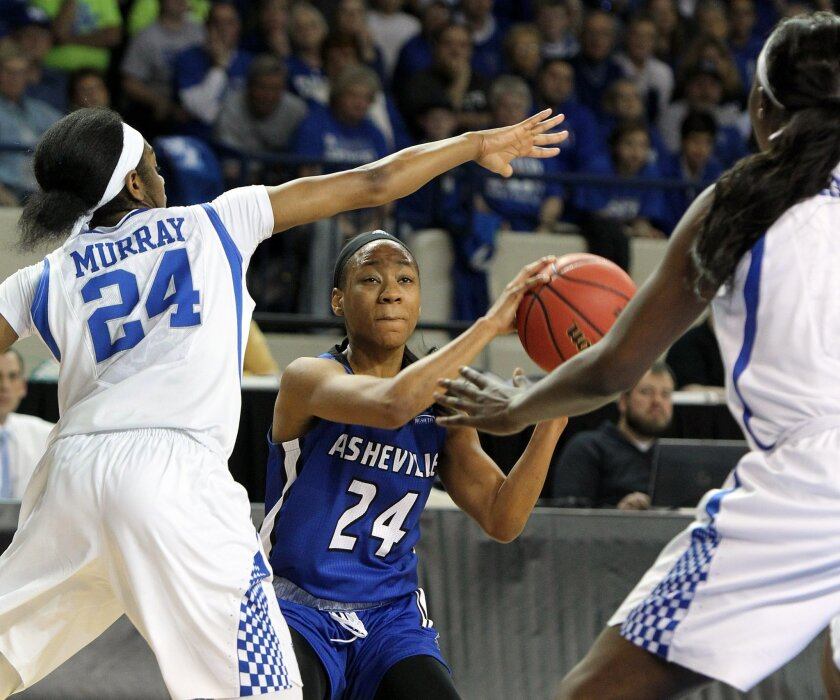 UNC Asheville's Ja'Da Brayboy, middle, looks for an opening between Kentucky's Taylor Murray, left, and Evelyn Akhator during a first-round women's college basketball game in the NCAA Tournament in Lexington, Ky., Saturday, March 19, 2016. (AP Photo/James Crisp)