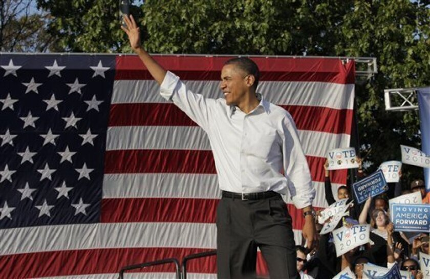 President Barack Obama waves at a rally in Philadelphia, Sunday, Oct. 10, 2010. (AP Photo/J. Scott Applewhite)
