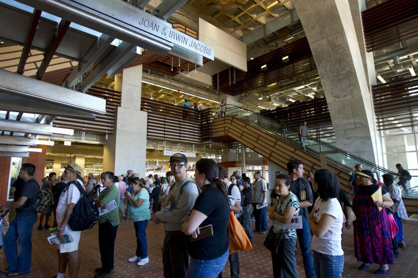 San Diegans line up to check out books on opening day for San Diego Central Library.