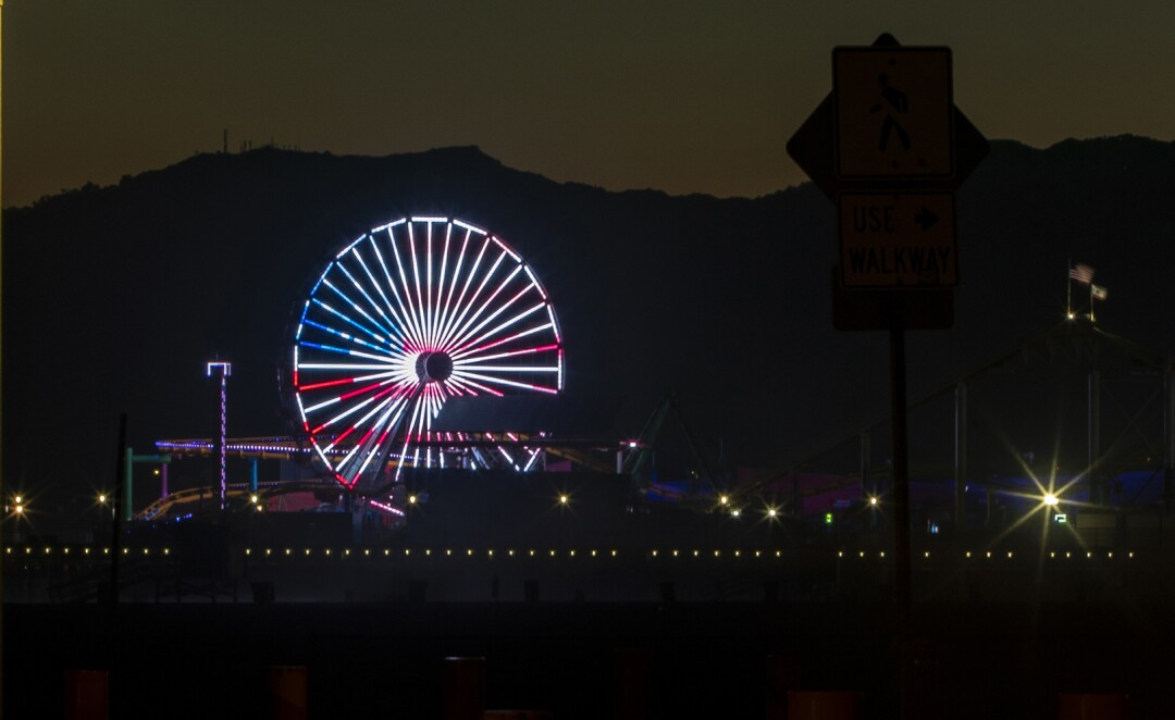 The Ferris wheel is lit in patriotic colors on July 4th weekend at the Santa Monica pier.