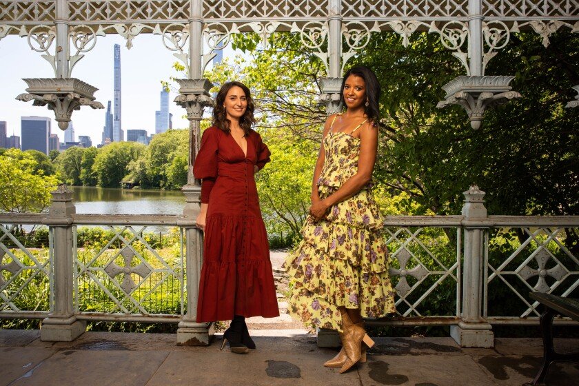 Sara Bareilles, left, and Renee Elise Goldsberry, right, who star in the Peacock show Girls5Eva