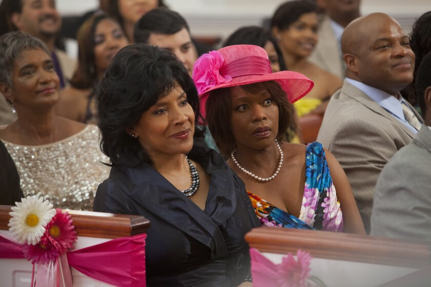 """Phylicia Rashad, left, and Alfre Woodard appear in a scene from Lifetime's """"Steel Magnolias."""" Woodard was nominated for an Emmy Award for best supporting actress in a miniseries or movie."""