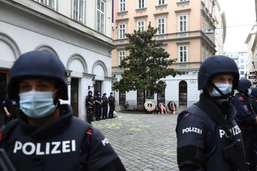 Police officers in Vienna on Tuesday, the morning after a terrorist attack that killed five people.