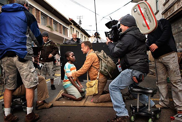 "Kiefer Sutherland and Siyabulela Ramba prepare for a scene during filming of ""24: Redemption,"" in Cape Town, South Africa. The two-hour special, which aired Nov. 23, 2008, on Fox, will kick off Season 7 for the hit series, but this photograph is one of 48 taken by cast and crew that was on display at the Paley Center for Media in Beverly Hills."