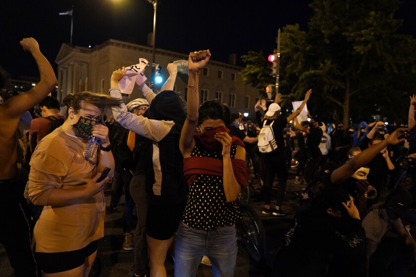 Demonstrators react as a helicopter circles low as people gather to protest the death of George Floyd, Monday, June 1, 2020, near the White House in Washington. Floyd died after being restrained by Minneapolis police officers. (AP Photo/Evan Vucci)