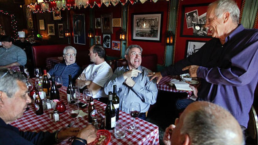 Michael Anderson, far right, co-owner of Chez Jay, a dive bar and small restaurant on Ocean Avenue in Santa Monica, chats with a customer.