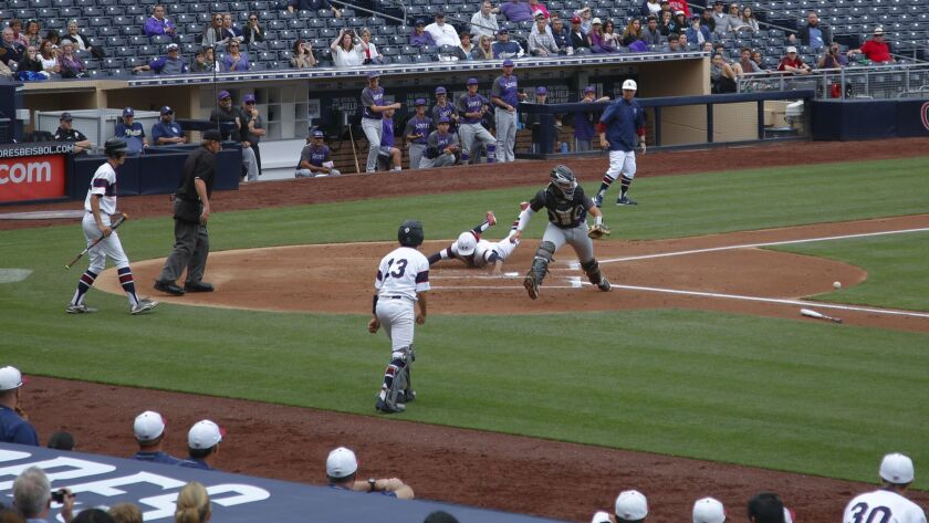 At Petco Park, Scripps Ranch #5Keith Davis scores in the 1st inning from a single hit by #16 Graiden