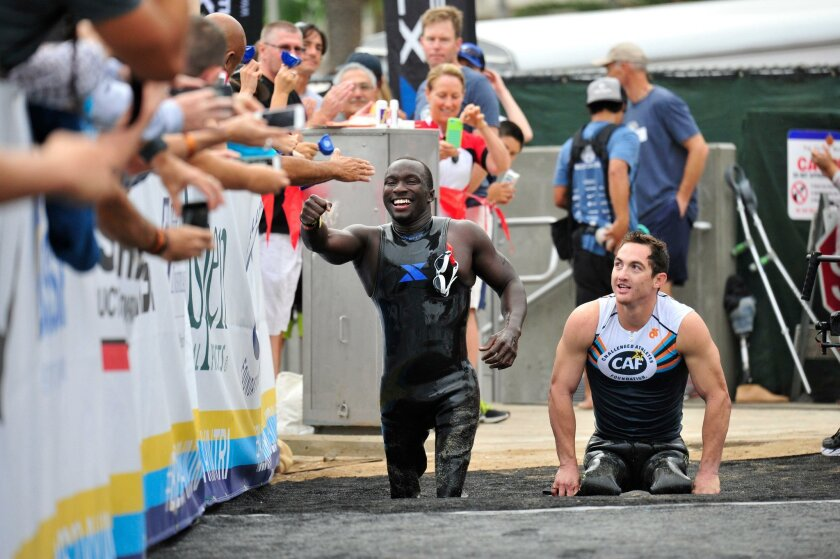 Roderick Sewell and Rudy Garcia-Tolson participating in the San Diego Triathlon Challenge after the swimming leg.