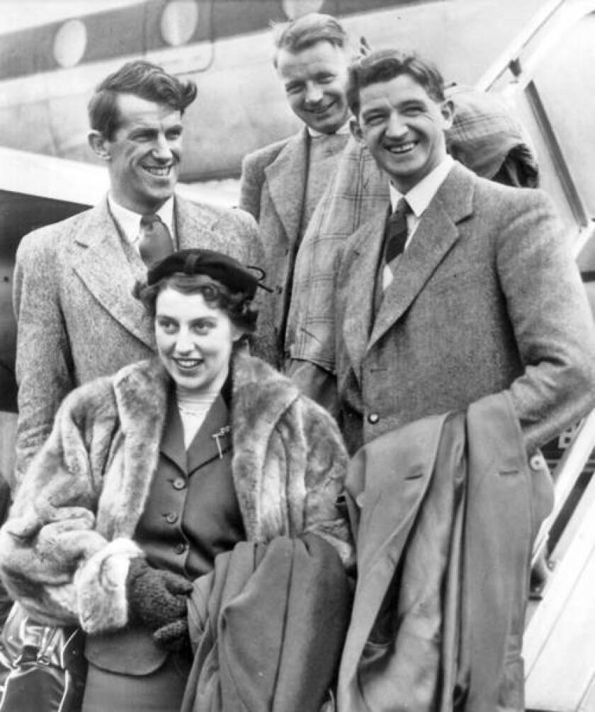 Sir Edmund Hillary, left, arrives in New York on Jan. 27, 1954, for a six-week speaking tour of the United States and Canada accompanied by his wife, Lady Hillary, Charles Evans and George Lowe.
