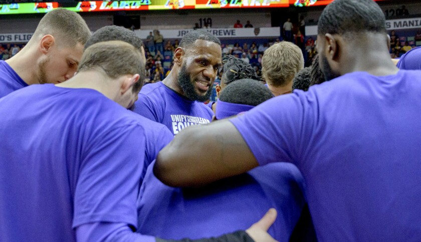 Los Angeles Lakers forward LeBron James (23) talks to the team before the first half of an NBA baske