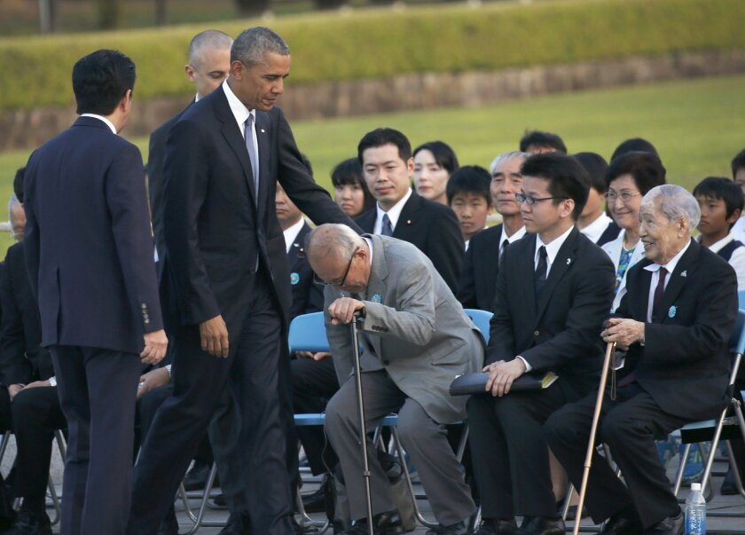 U.S. President Barack Obama, second from left, greets Shigeaki Mori, an atomic bomb survivor, third from right, and Sunao Tsuboi, right, chairman of Japan Confederation of A-and H-Bomb Sufferers Organizations, during a ceremony at Hiroshima Peace Memorial Park in Hiroshima, western, Japan, Friday,