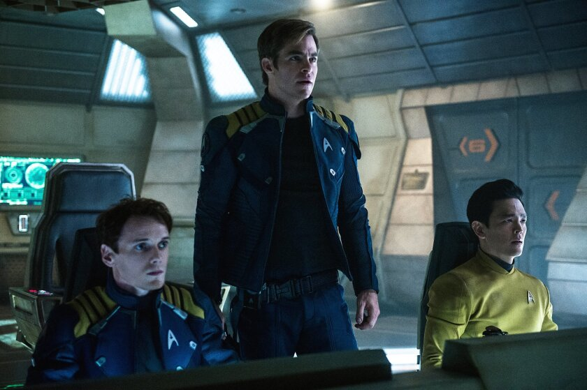 """In this image released by Paramount Pictures, from left, Anton Yelchin, Chris Pine and John Cho appear in a scene from, """"Star Trek Beyond."""" (Kimberley French/Paramount Pictures via AP)"""