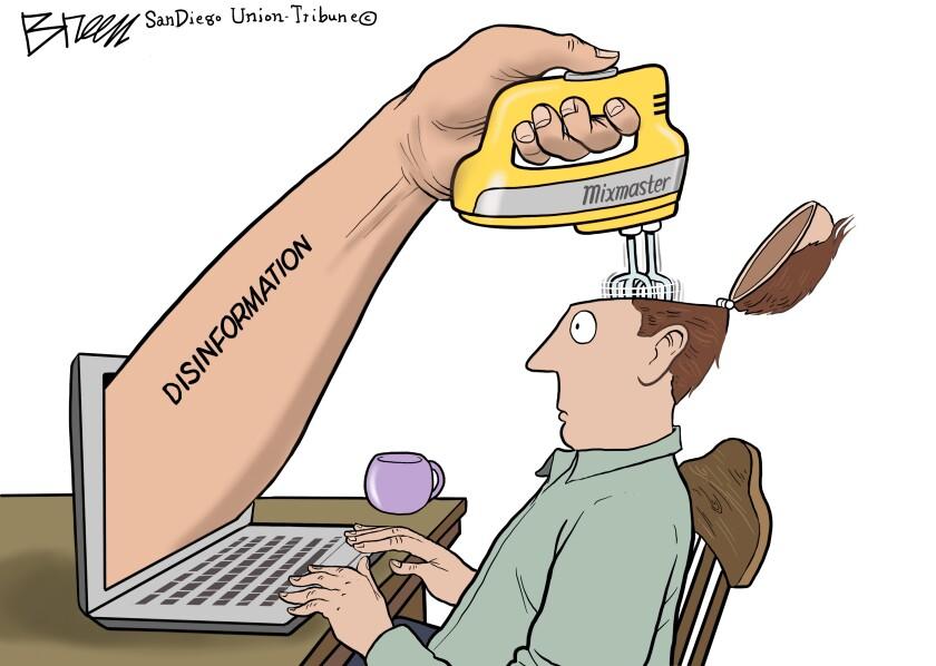 A hand labeled 'disinformation' holding an electric mixer is scrambling the brain of a voter in this Breen cartoon
