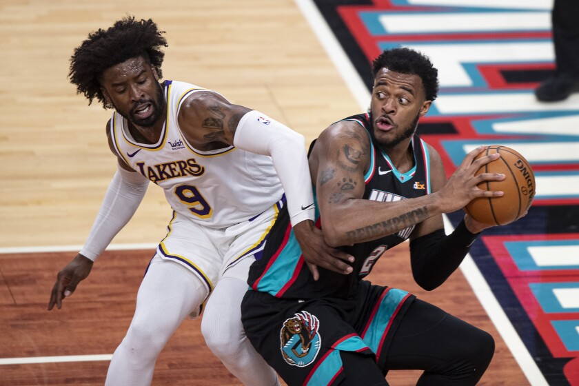 Memphis Grizzlies forward Xavier Tillman keeps the ball from Lakers guard Wesley Matthews.
