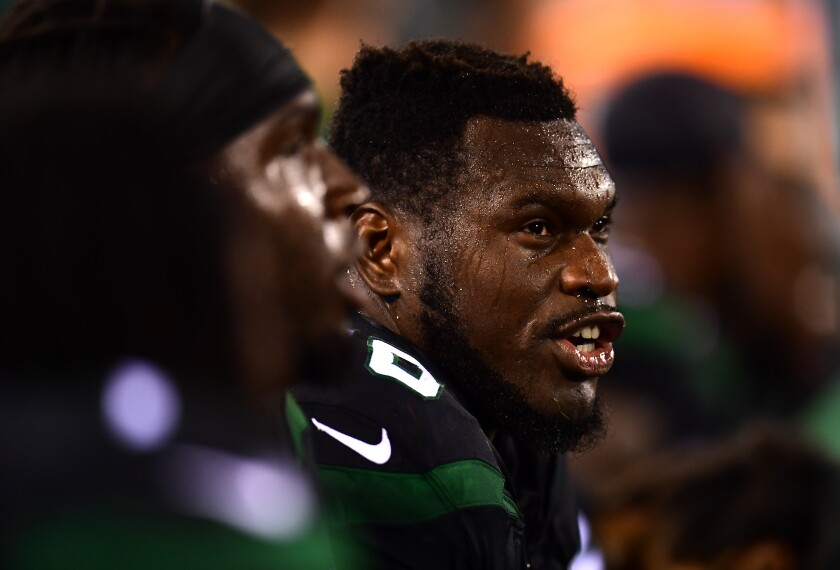 Kelechi Osemele sits on the sidelines during the Jets' game against the Browns on September 16.