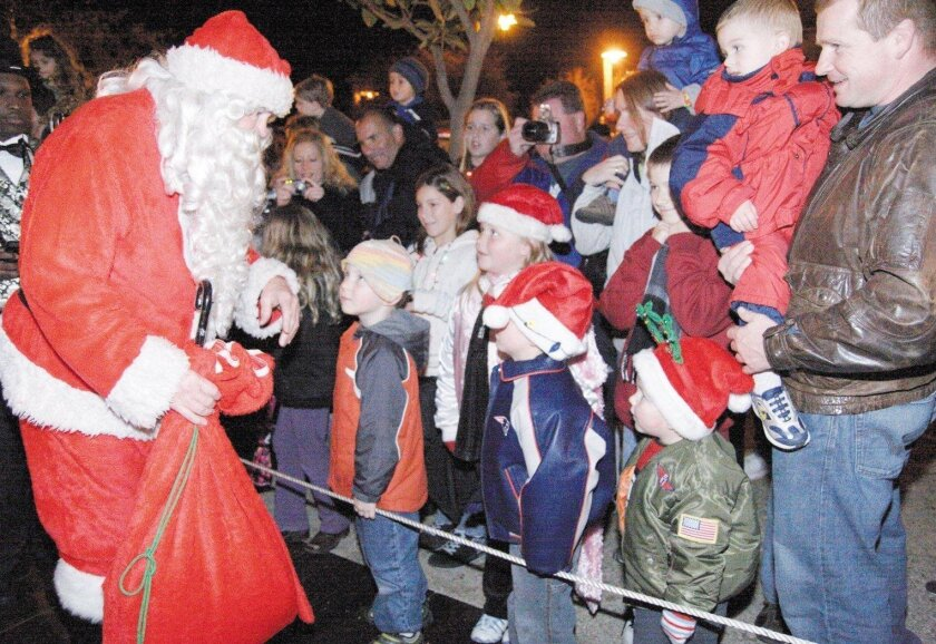 Santa will arrive by train to to greet kids at Poway's Christmas in the Park.