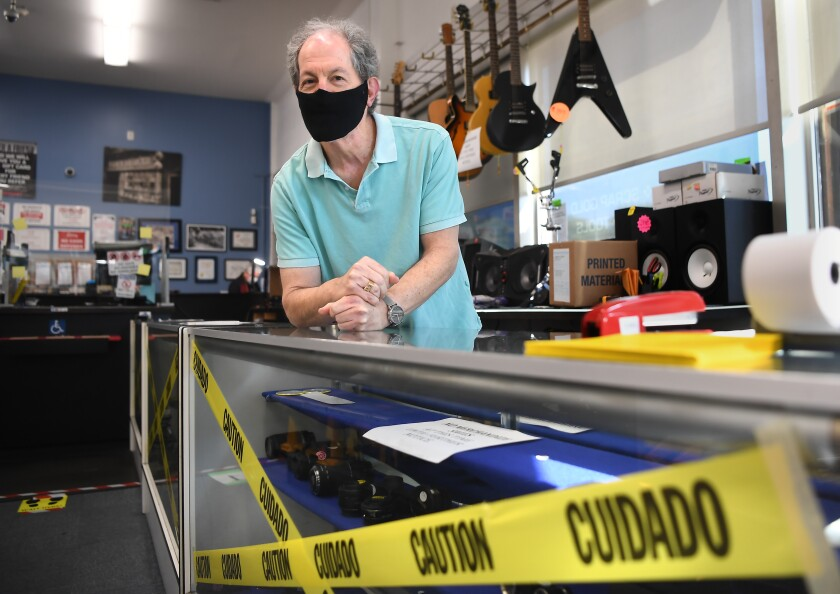 Manager Danny Justman stands inside Pawnmart business in Norwalk.