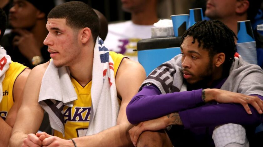 Lakers' Lonzo Ball, left, and Brandon Ingram are sidelined because of injuries and the Lakers are feeling the void.