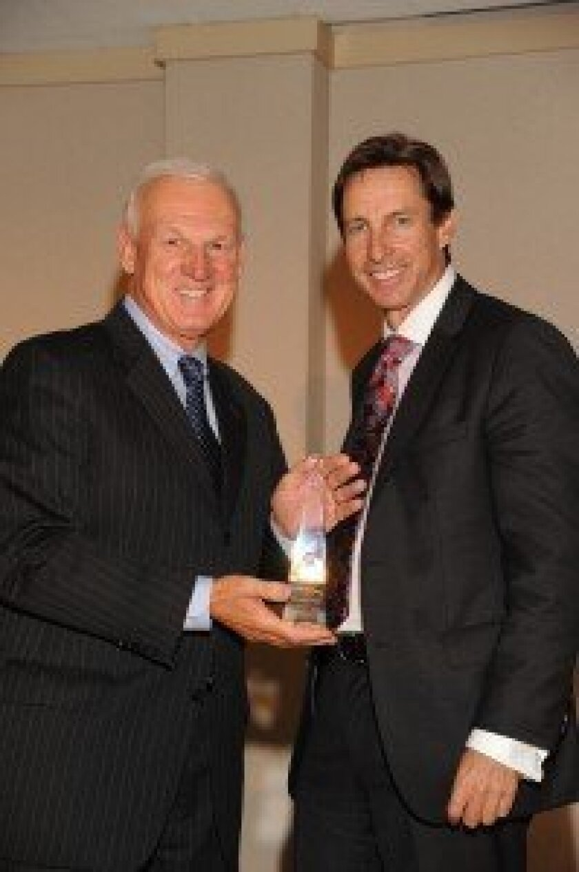 County Supervisor Ron Roberts (left) presents the Millennium Award to Tom Gildred. Courtesy photo