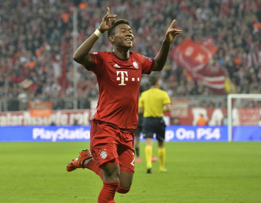Bayern's David Alaba celebrates after scoring his side's third goal during the Champions League Group F soccer match between Bayern Munich and Arsenal FC in Munich, southern Germany, Wednesday, Nov. 4, 2015. (AP Photo/Kerstin Joensson)