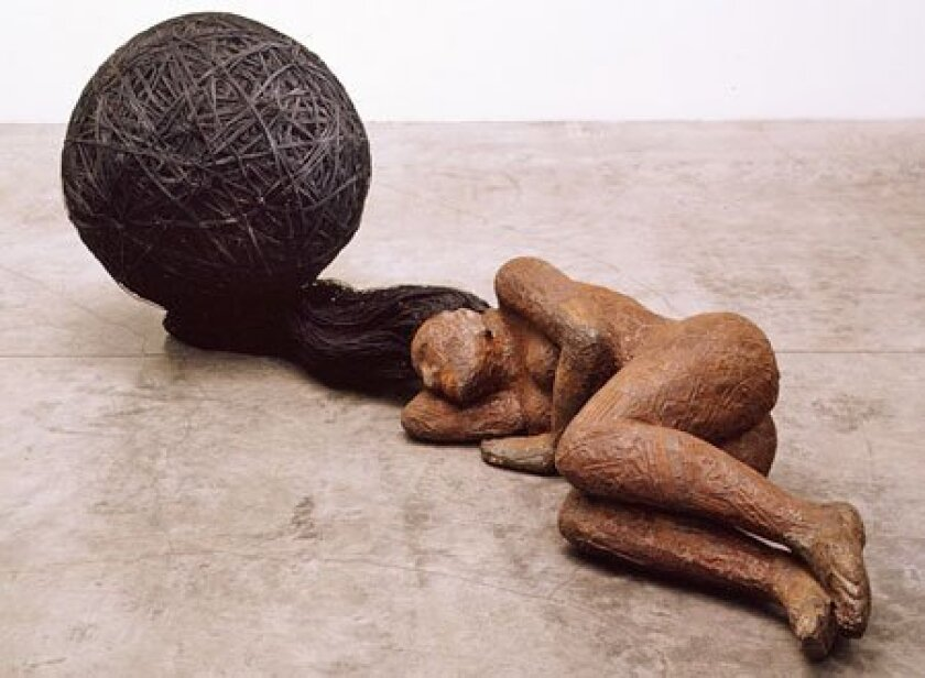 """""""Cache,"""" a figure in wood by Alison Saar, is among the recent works in the """"Black Womanhood"""" exhibition. (L.A. Louver Gallery)"""