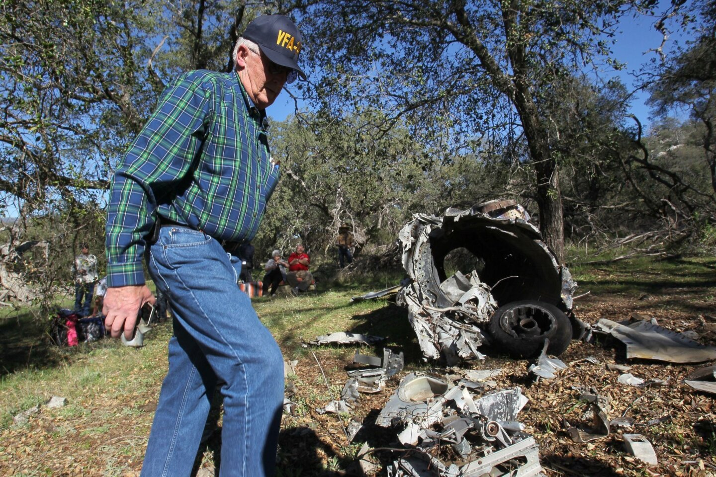 "Former Navy pilot Bob Jones walked around the site where the FJ-4B ""Fury"" jet aircraft he had to bail from in 1957 after an engine failure came to rest on Rancho Guejito."