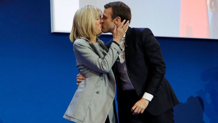 French presidential candidate Emmanuel Macron kisses his wife Brigitte Trogneux in Paris on April 23