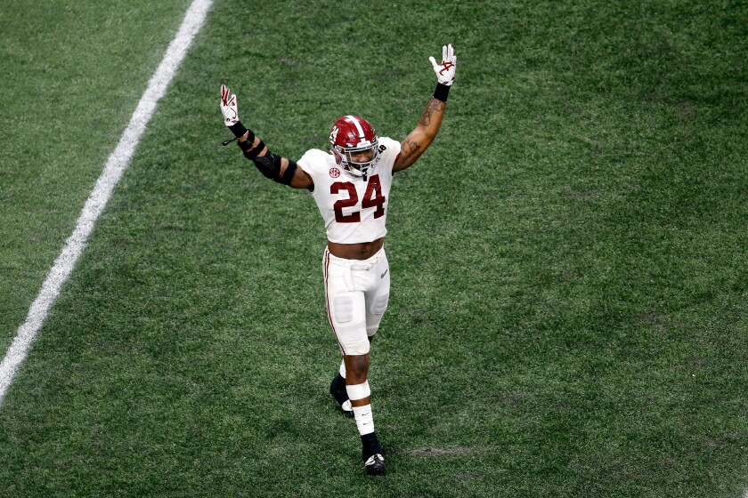 Alabama linebacker Terrell Lewis celebrates in January 2018 after the Crimson Tide won the national title.