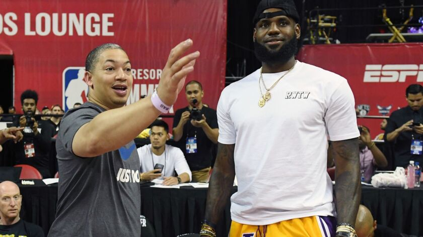 Tyronn Lue and LeBron James chat during a game at the 2018 Las Vegas Summer League tournament.