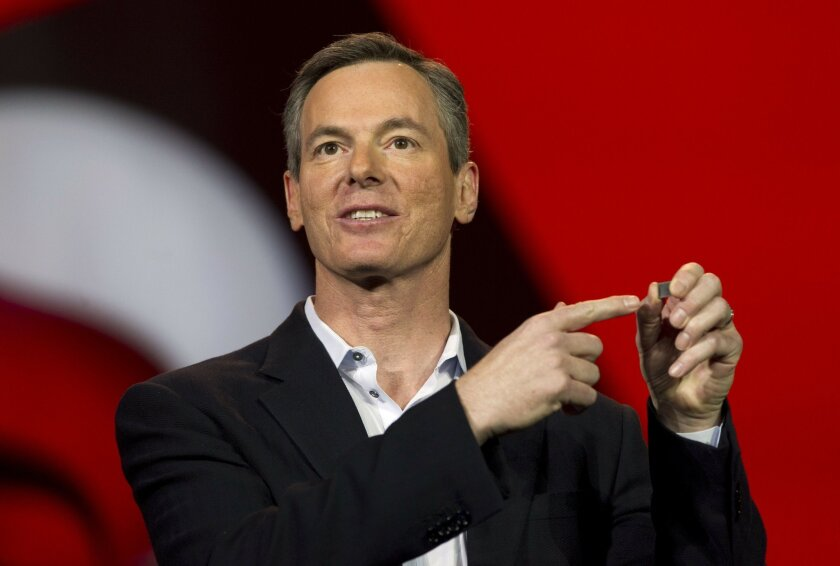 Qualcomm CEO Paul Jacobs, this year's keynote speaker for the Consumer Electronics Show, shows off the new Snapdragon 800 Series processor while making his speech at the Venetian Resort Hotel Casino in Las Vegas, Nevada on Monday.