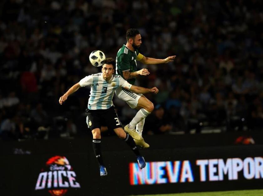 Argentina's Nicolas Tagliafico (L) vies for the ball with Mexico's Miguel Layun (R) during a friendly soccer match at Mario Alberto Kempes Stadium in Cordoba, Argentina, on Nov. 16, 2018. EPA-EFE/HERNAN CORTEZ