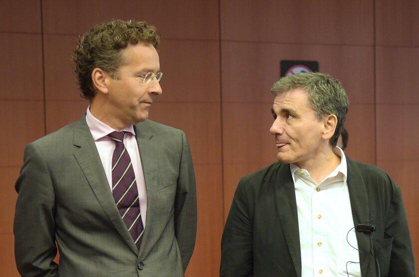 Eurogroup President and Dutch Finance Minister Jeroen Dijsselbloem, left, and Greek Finance Minister Euclid Tsakalotos talk Aug. 14 during a Eurogroup meeting at the European Union headquarters in Brussels.