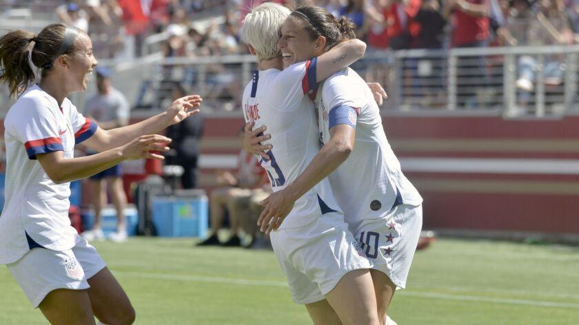 U.S. forward Carli Lloyd (10) gets a hug from forward Megan Rapinoe (15) after Lloyd scored a goal i