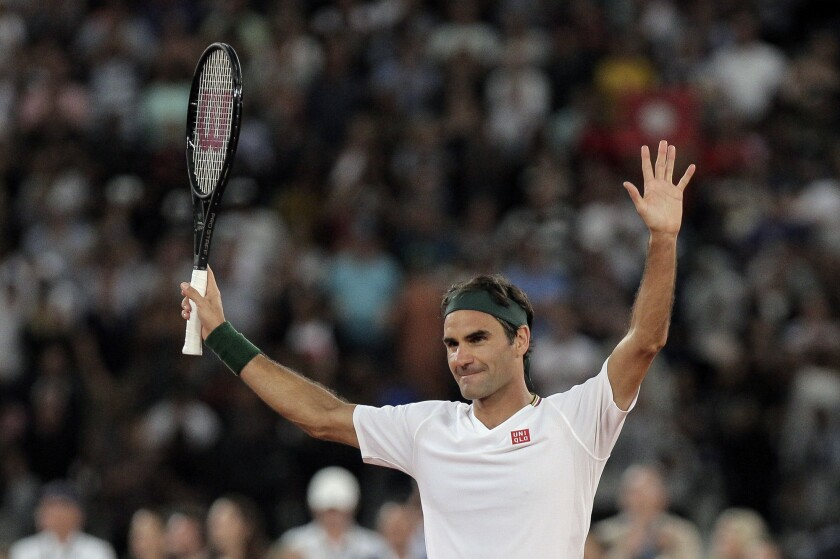 FILE - In this file photo dated Friday Feb. 7, 2020, Roger Federer thanks the crowd after winning 3 sets to 2 against Rafael Nadal in their exhibition tennis match held at the Cape Town Stadium in Cape Town, South Africa. The 20-time Grand Slam champion Roger Federer will face the winner of the match between Jeremy Chardy and Dan Evans in the Qatar Open next week in his first competition for more than a year. (AP Photo/Halden Krog, FILE)
