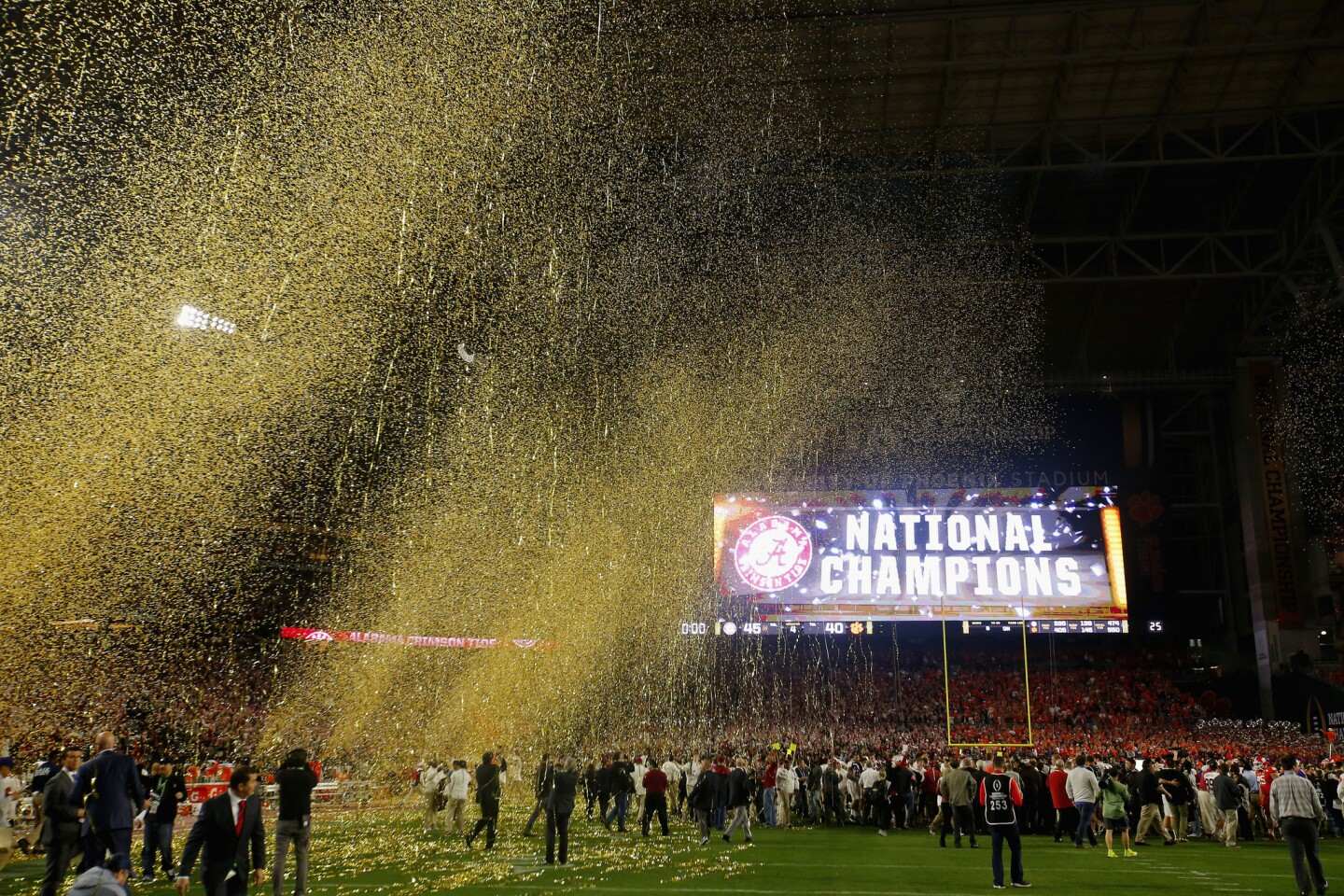 Confetti falls as the Alabama Crimson Tide celebrates after defeating the Clemson Tigers in the 2016 College Football Playoff championship game.