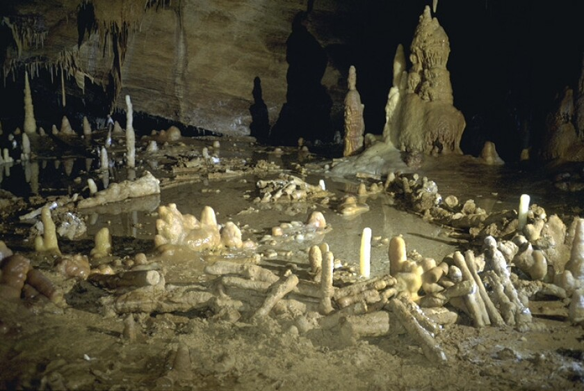 Archaeologists say the circular structures discovered deep in a cave in southwestern France were constructed by Neanderthals 176,000 years ago.