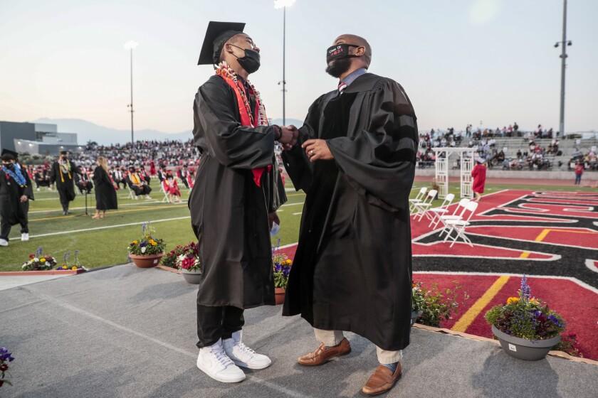 Sierra Vista High Principal Vince Pratt offers a warm congratulations to Johnny Sen at graduation.