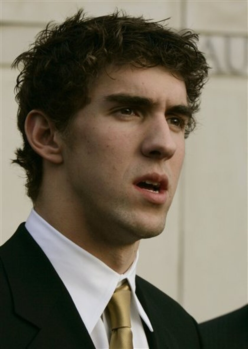 """In this Wednesday, Dec. 29, 2004 file photo, Olympic gold medal swimmer Michael Phelps speaks to reporters after pleading guilty to drunk driving charges in district court in Salisbury, Md. Phelps acknowledged """"regrettable"""" behavior and """"bad judgment"""" after a photo in a British newspaper Sunday, Feb. 1, 2009, showed him inhaling from a marijuana pipe. (AP Photo/Chris Gardner)"""