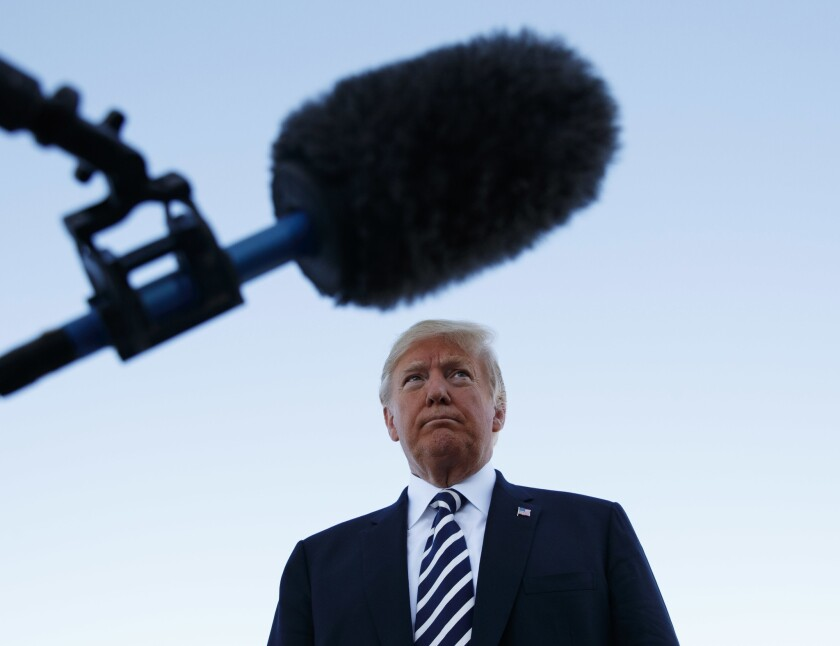 President Trump pauses as he speaks to media after a campaign rally before boarding Air Force One in Nevada on Saturday.