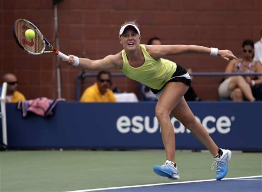 Alison Riske returns a shot to Petra Kvitova, of the Czech Republic, during the third round of the 2013 U.S. Open tennis tournament, Saturday, Aug. 31, 2013, in New York. (AP Photo/Julio Cortez)