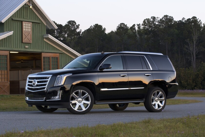 The 2015 Cadillac Escalade is based on the more humble Chevy Tahoe, itself based on GM's trucks. Though the Cadillac is sharply designed, comfortable, and quiet, it can't mask its roots like an $88,000 luxury SUV should.