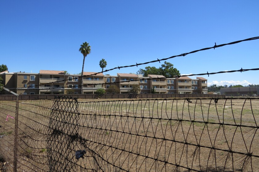 A retirement apartment community sits next to a vacant lot at the intersection of Washington Avenue and Ash Street where the Escondido City Council decided to build a recycled water treatment plant in 2017. That decision is now being revisited.. File Photo