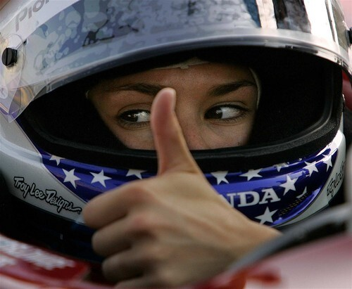 Indy Racing League rookie Danica Patrick gives the thumbs up to a crew member as he adjusts her mirrors before practice at the Kentucky Speedway in Sparta.