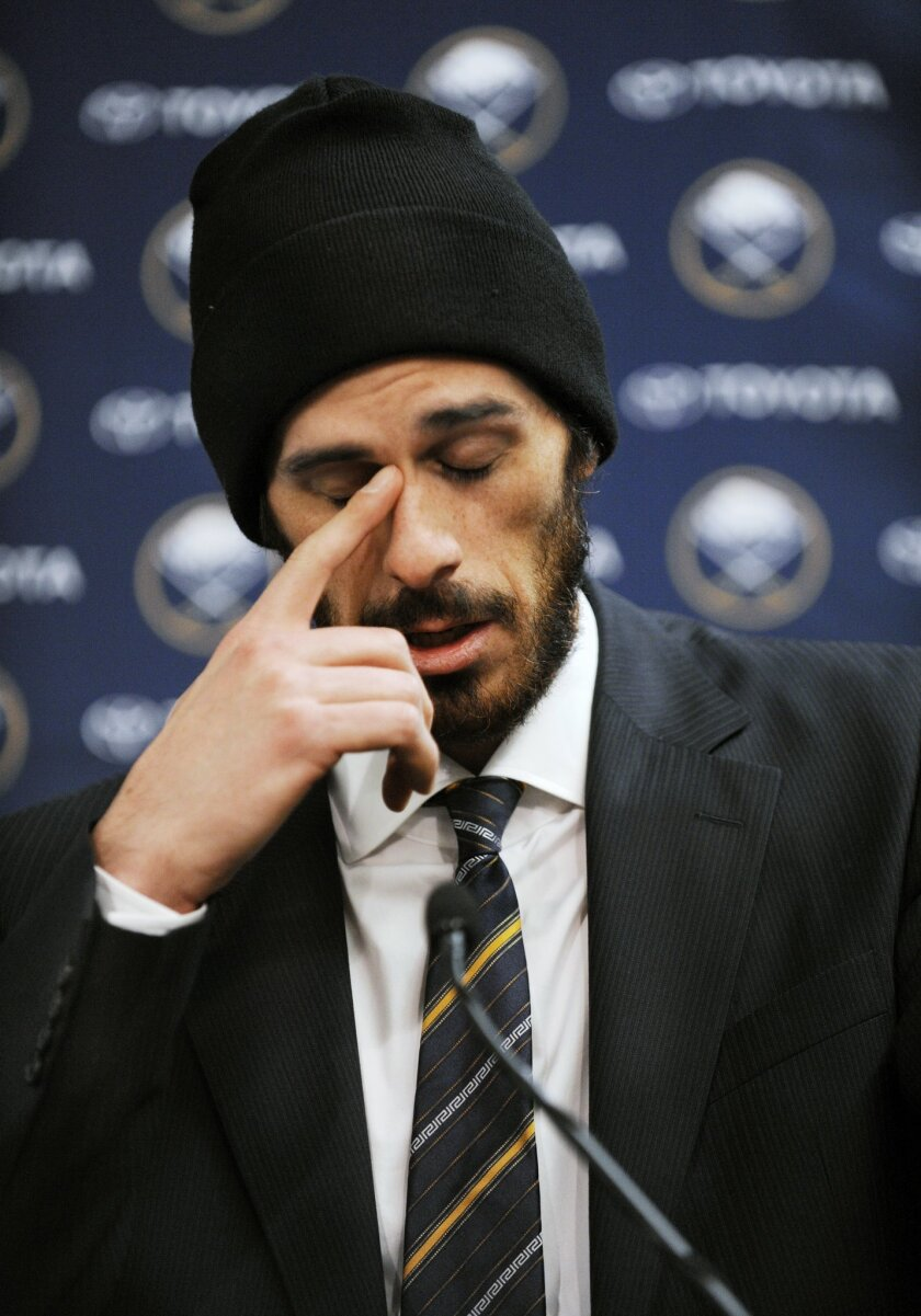 Former Buffalo Sabres goaltender Ryan Miller collects his thoughts during a news conference as he talked about his years with the NHL hockey team, Friday, Feb. 28, 2014, in Buffalo, N.Y. Miller and Steve Ott were traded to the St. Louis Blues Friday night for goalie Jaroslav Halak, forward Chris St