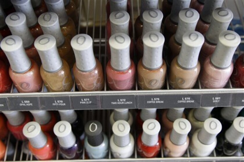 "Nail care products are displayed at a beauty supply shop in San Francisco, Monday, April 9, 2012. California's chemical regulators randomly sampled dozens of professional grade nail polishes that claimed to be free of a ""toxic trio"" of dangerous substances and found that many still contained the chemicals in high levels. (AP Photo/Marcio Jose Sanchez)"