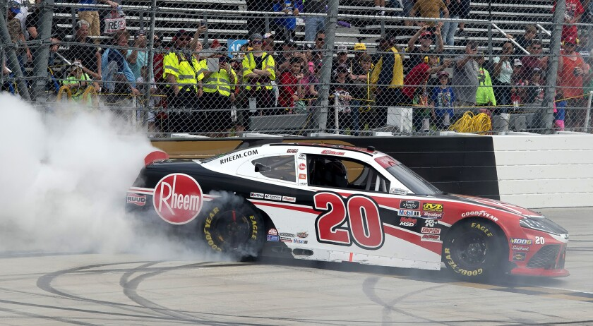 Christopher Bell does a burn out after winning the NASCAR Xfinity Series auto race, Saturday, May 4,