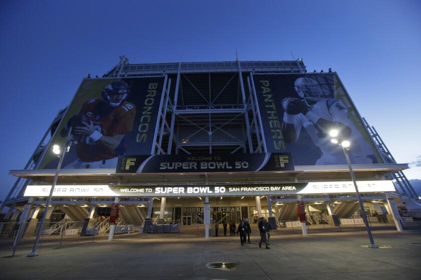 The entrance to Levi's Stadium is decorated with images of Denver Broncos quarterback Peyton Manning, left, and Carolina Panthers quarterback Cam Newton in Santa Clara, Calif.