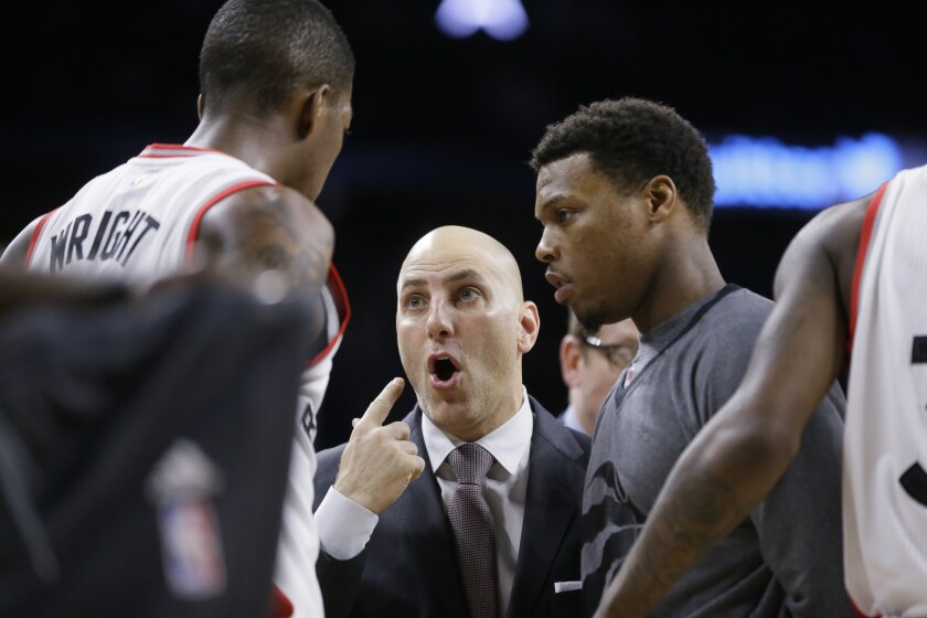 Rex Kalamian talks with guard Delon Wright while coaching the Raptors in 2016.